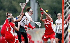 Women's Lacrosse players scoring a goal