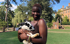 Salimata Sanfo posing with a bunny in her arms in the Sunken Garden.