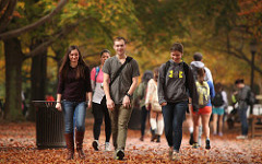 students walking between classes in fall