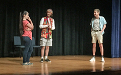 Students on stage performing