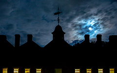 Cloudy night sky with full moon over the wren at night