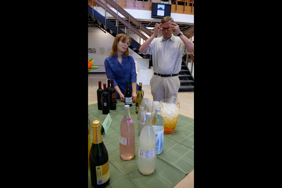 Professors Naomi Falk and John Lee admire our fine assortment of beverages.