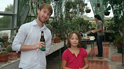 Current graduate student Mark Guillotte after helping set up, with Dr. Kerscher's daughter Stella.