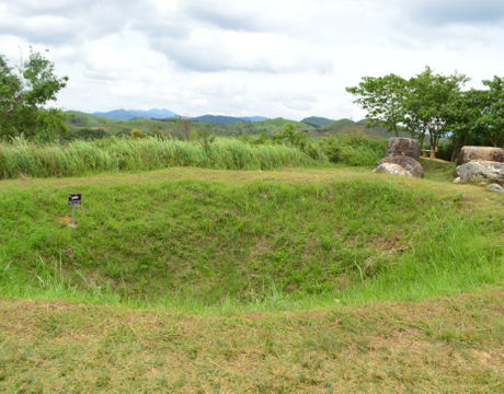 A bomb crater on the Plain of Jars in Laos