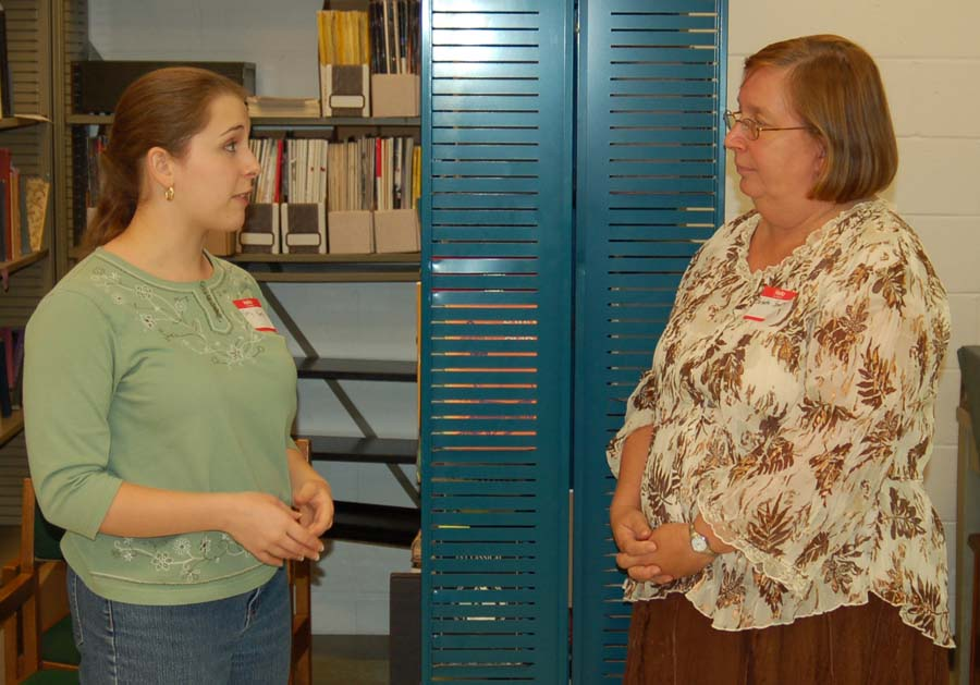 Alumna Emily Kamp chatting with Professor Barbette Spaeth
