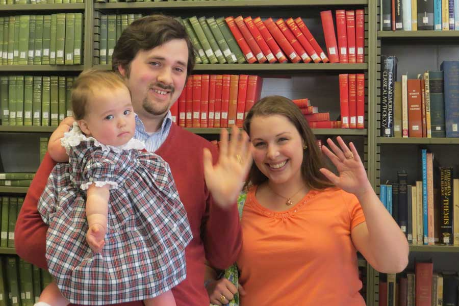 CJ Kamp '08 and Emily Rossow Kamp '08 with their daughter Lily