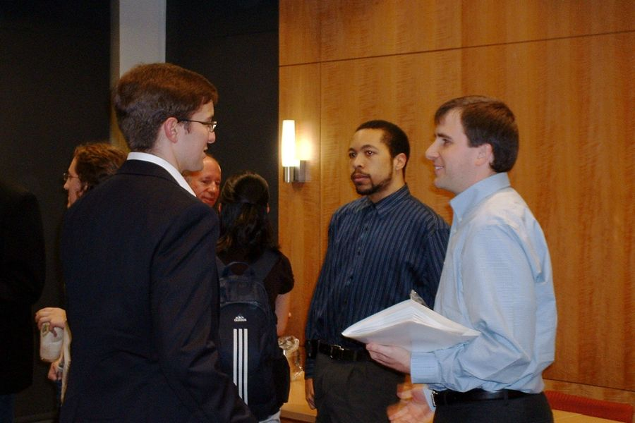 Panelist Carl Otto (B.S., '07) speaks with attendees