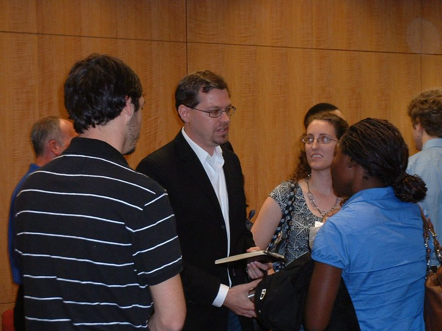 Panelist Jeremy Beker (M.S., '08) speaks with attendees