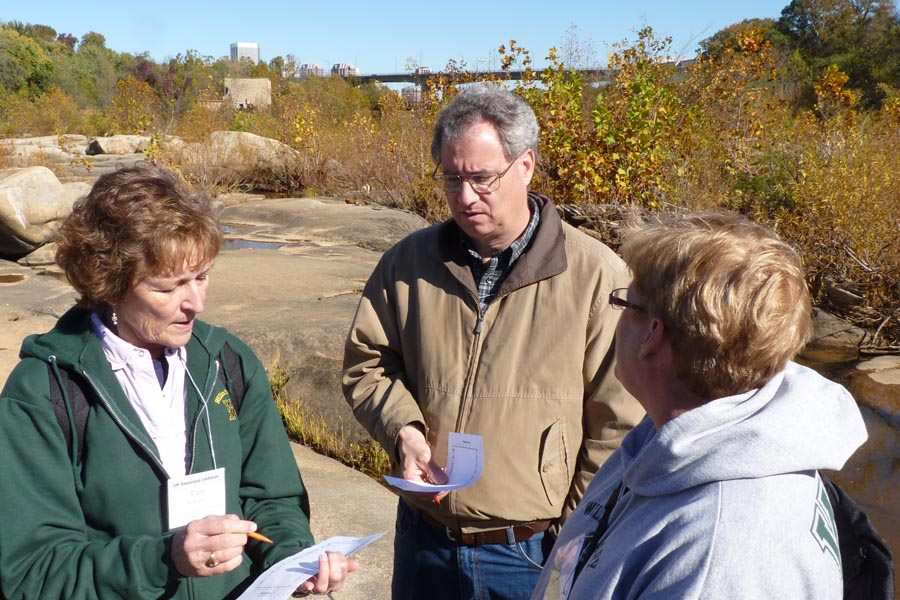 Pam Wilkinson ('76), Jim Firebaugh ('74), and Debbie Firebaugh consider the Depth-Time-Temperature profile of the Petersburg Granite