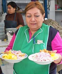 Doña Mary, serving ceviche in a popular market, is one of the many who went from food stand owner to successful entrepreneur.
