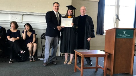 Hannah Rennolds receiving her diploma on stage