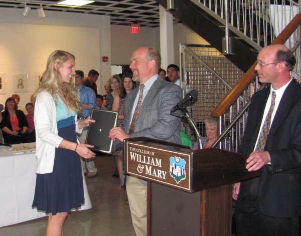 Kiah Hardcastle receives her Excellence in Neuroscience Award from Dr. Greg Smith