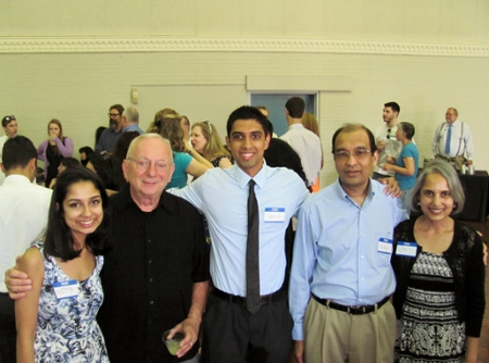 Graduate Varun Takanti introduces his family to Dr. Randy Coleman