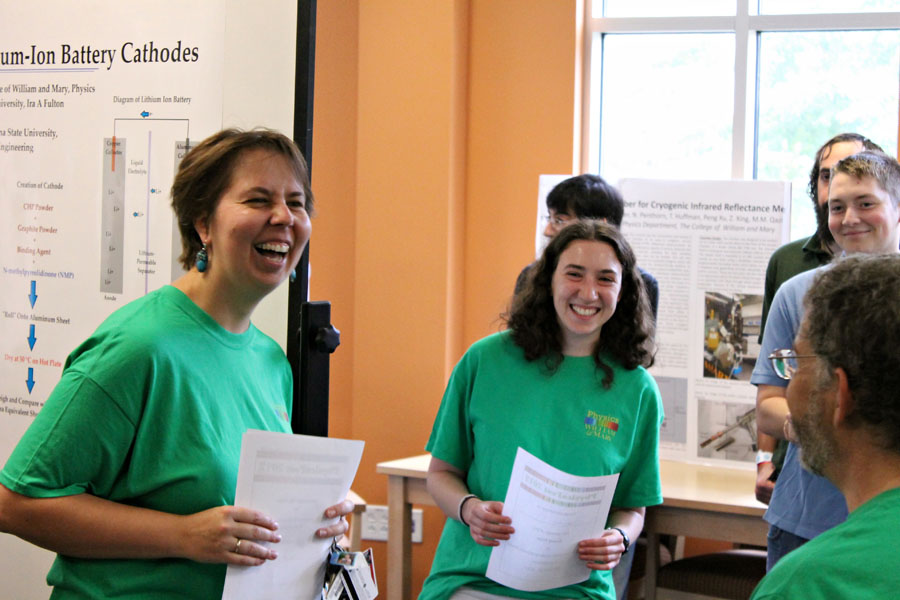 Having fun at the undergraduate research poster session.  Photo credit J. Hill
