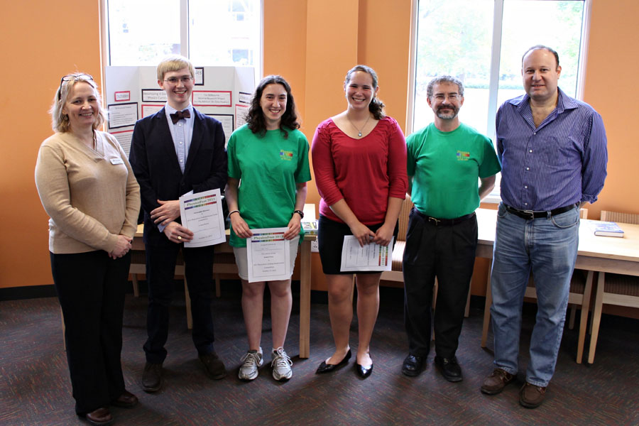 Winners of the undergraduate research poster competition pose with the judges.  Photo credit J. Hill