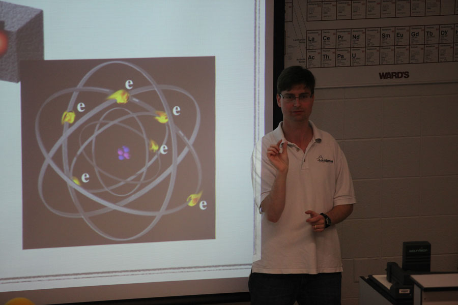 Prof. Erlich explains the nature of matter.   Photo credit S. Salpukas