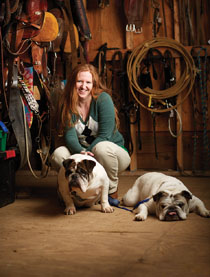 Elisabeth Custalow '01 volunteers as executive director of Four Feet Forward. She has two dogs, Tank and Winston, and two horses, Breezy and Emma. Photo by Adam Ewing