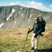 In this 1998 photo, Ken Kambis is descending Mount Elbert, with Mount William & Mary in the background.