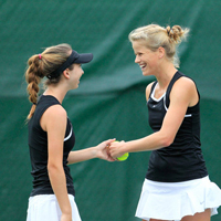Olivia Thaler (left) and Jeltje Loomans celebrate a point won.