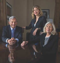 Oncologist Vince DeVita Jr. '57, D.Sc. '82 (left) with wife Mary Kay Bush DeVita '57 (right) and their daughter, Elizabeth DeVita Raeburn (Photo by Don Hammerman)