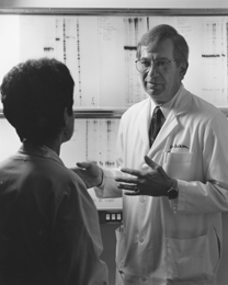 DeVita discusses lab results with a researcher at Yale Cancer Center where he served as director from 1993-2004. He is now the Amy and Joseph Perella Professor of Medicine at Yale. (Photo courtesy of Farrar, Straus and Giroux)