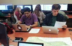 "Students crowd the CGA for a GIS Day ""mapathon,"" in which volunteers remapped features in earthquake-stricken Afghanistan. CGA photo"