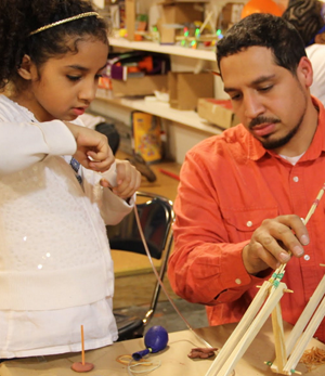 A student receives hands-on help from an engineer. Image courtesy of Iridescent.