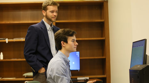 Alex Williams '17 and Psychology Professor Chris Conway analyze data from an experiment, including the participant's physiological signs of fear, in the lab.  Photo by Stephen Salpukas