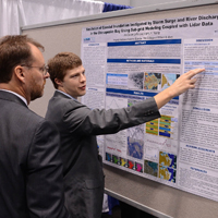 VIMS graduate student Jon Loftis discusses his work on storm-surge modeling during a scientific meeting.
