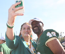 W&M Athletics Director Samantha Huge takes a photo with Warren Winston '72. (Photo by Stephen Salpukas)