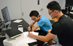 Cedar Ren (left) and John Liu work on the predictive, computational aspects of the ''biomathy'' project.