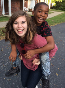 Isabella Bartels '18 with Bryce, one of the students who participates in the Lafayette Kids program (Photo by Elizabeth Ransone '18)