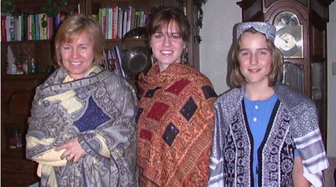 Marna and her children wearing clothing sent to them from Afghanistan