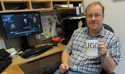 Eugeniy Mikhailov takes a celebratory sip from his LIGO mug after watching the NSF webcast.