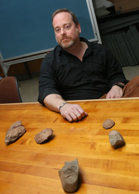 Norman found other ancient tools, including two Achulean hand axes, an awl and a scraper, whose ages vary from 100,000 to a million years old. (Photo by Stephen Salpukas)