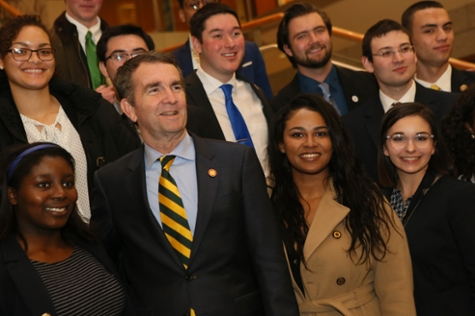 Gov. Ralph Northam poses for a photo with students. (Photo by Stephen Salpukas)
