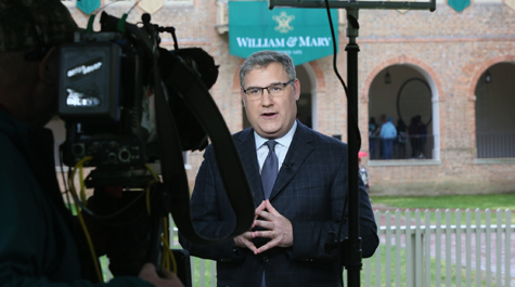 CNN reporter Mark Preston broadcasts near the Wren Building on Wednesday. (Photo by Stephen Salpukas)