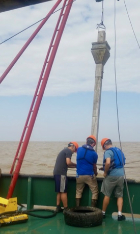 Members of the research team retrieve a core from the bottom sediments of the Andaman Sea off Myanmar's Irrawaddy-Salween Delta.
