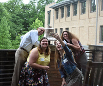 Education students take a selfie with the School of Education's bell during a scavenger hunt designed to help them get to know the building. (Photo courtesy of the W&M School of Education)