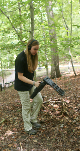 Olivia Windorf listens for a signal relayed from the transponder-toting toad. Her apparatus can detect toads a meter or so underground. (Photo by Stephen Salpukas)