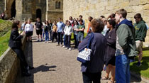 Wind Ensemble members listen to a tour guide at Alnwick Castle, England, which is where several Harry Potter movies were filmed. (Photo by Richard Marcus)