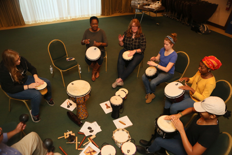 Students participate in a drum circle. (Photo by Stephen Salpukas)