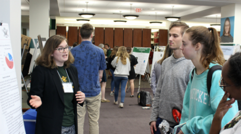 A student shares with attendees of the symposium. (Photo by Andy Harris)
