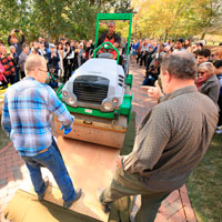 Steve Prince drives the steamroller over the first woodcut block panel. (Photo by Stephen Salpukas)