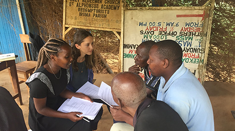 A William & Mary student speaking with smallholder farmers in rural Kenya.