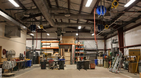 Scene shop with equipment, tools, cabinets, work area