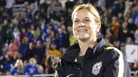 Jill Ellis in a soccer stadium