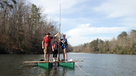 geologist Jim Kaste works with undergraduates Kassandra Smith and Meredith Meyer from a coring platform assembled from a couple of lashed-together canoes on Lake Matoaka.