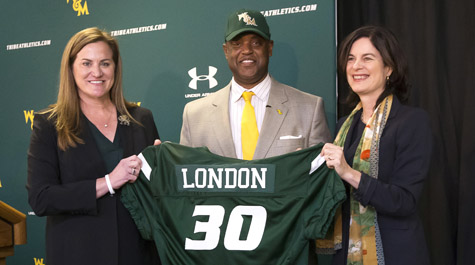 Huge with football coach Mike London and President Katherine Rowe