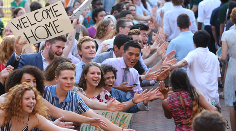 William & Mary students welcome the freshman class with high-fives at the 2019 Opening Convocation ceremony.